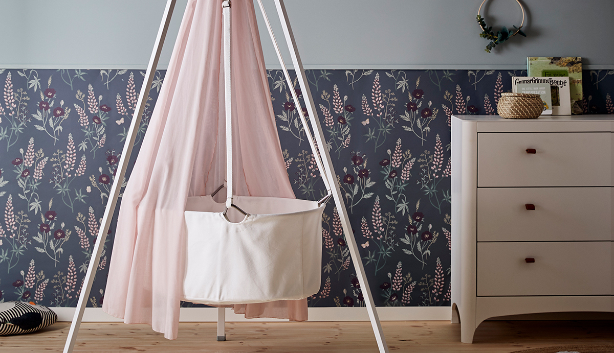 baby girls nursery with white Leander cradle and pink canopy