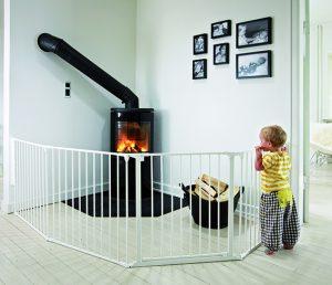 White /babyDan Flex Configure System keeps boy safe from fire place