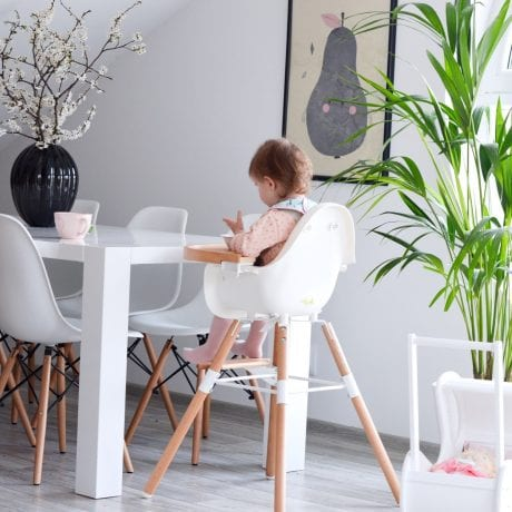 white dining room with girl in Evolu 2 high chair at the table