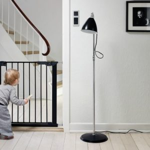 Premier pressure gate in balck in doorway with child peering through the bars