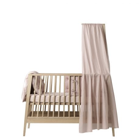 Linea by Leander Cot in natural with pink canopy and bedding