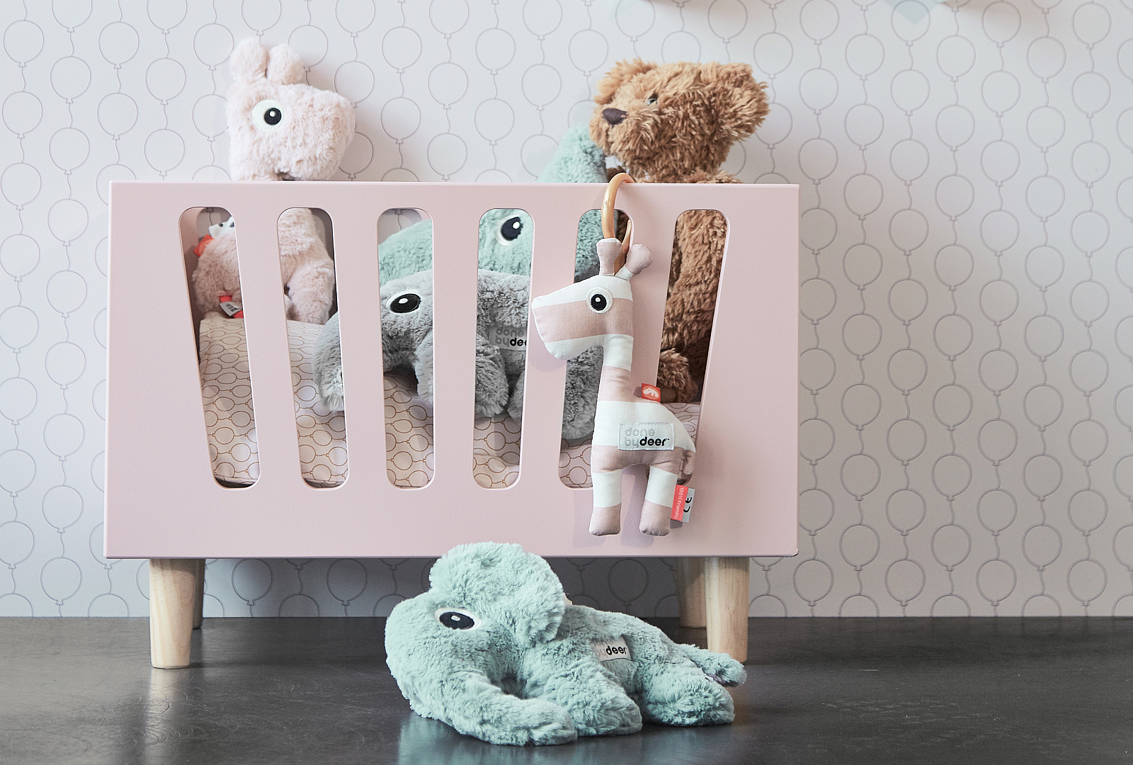 Pink dolls bed and soft toys from Done by Deer