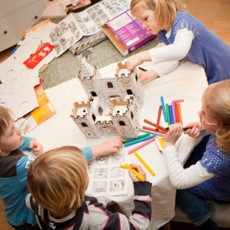 kids doing a kids craft project from Calafant together as a group