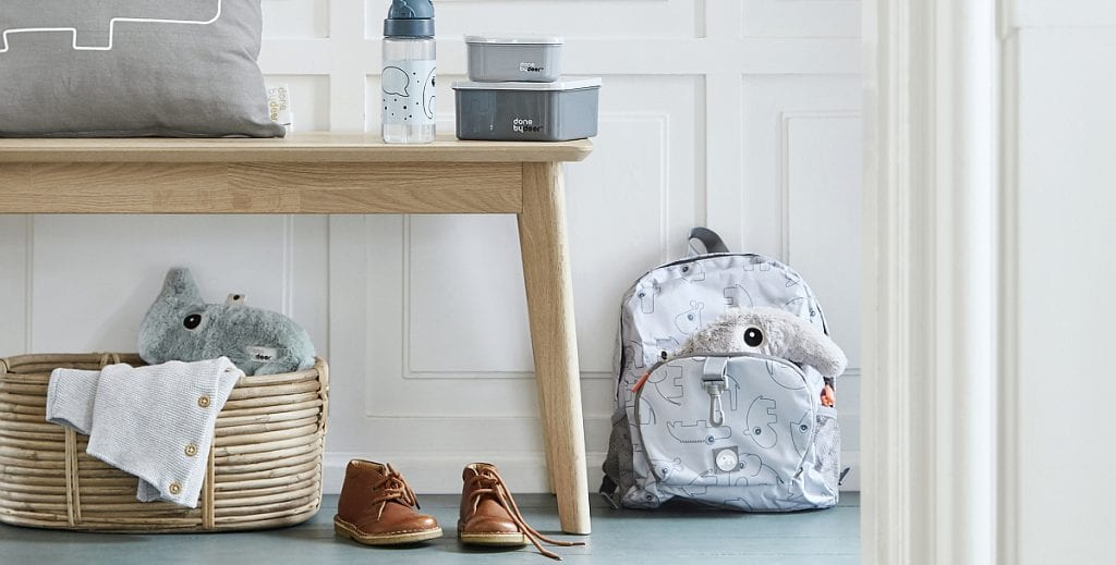 Family hallway with Done by Deer back pack, lunch box and drink bottle in grey