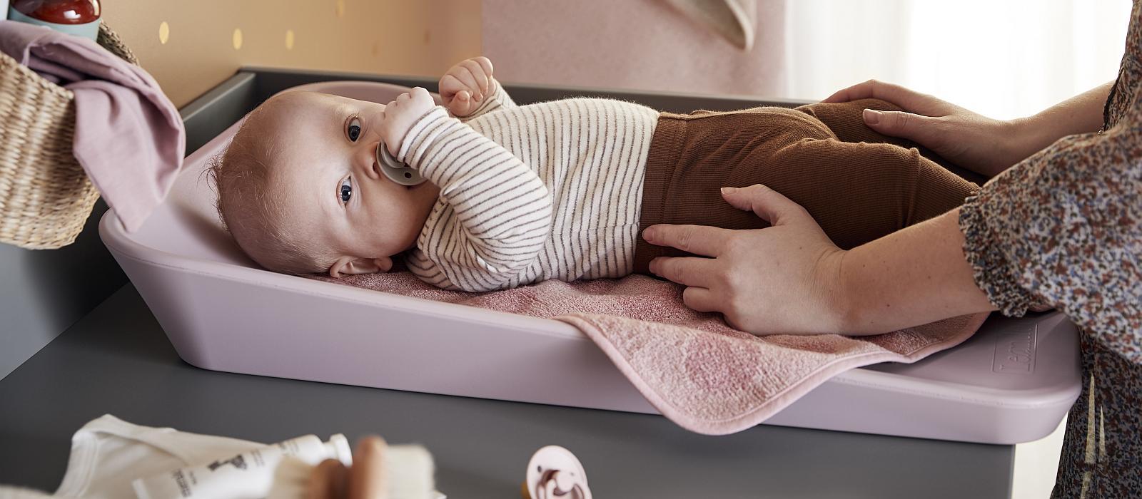 Baby girl on pink Leander Matty mat