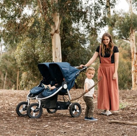 Mum and her two boys with herBumbleride Indie Twin stroller in navy blue in the bush