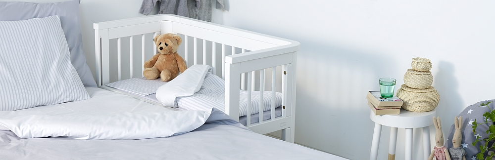 Troll sun bedside bassinet in white in white modern bedroom