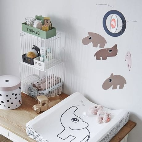 Baby change station with Done by Deer mat and mobile