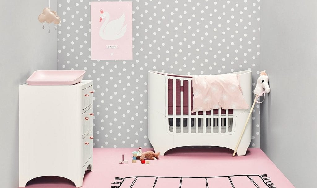 Pink and grey nursery with white Leander baby cot and dresser