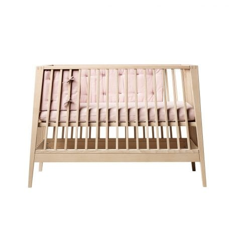 Linea by Leander cot in natural beech with pink bumper