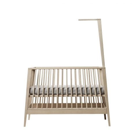 Linea cot with base in infate setting and canopy rod fitted