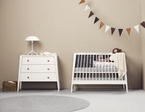 Whitel Linea by Leander Cot and dresser in neutral room with bunting