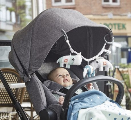 Done by Deer pram toy in blue on grey pram and happy baby smiling