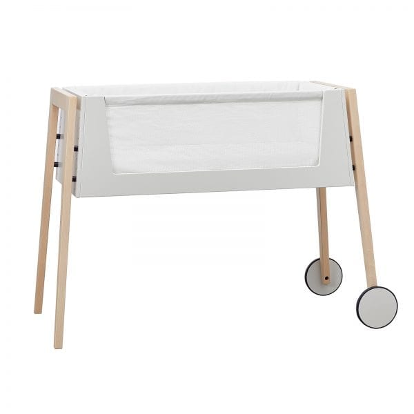 Linea by Leander bedside bassinet in natural with side up