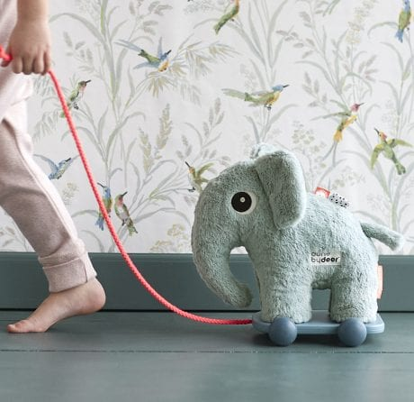 child pulling the Done by Deer elephant pull-along toy