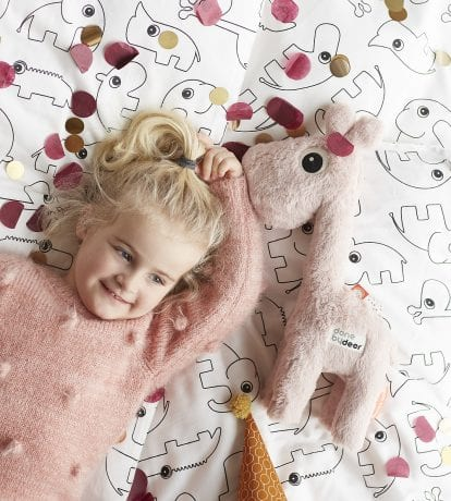 pink super plush giraffe from Done by Deer with cute blond girl