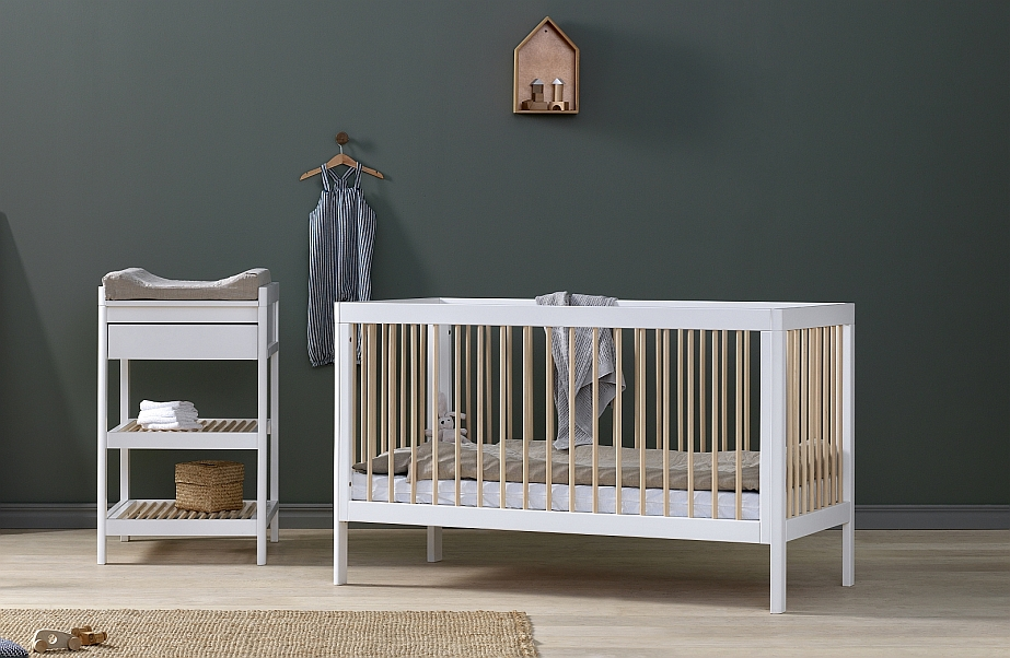 Lukas cot and change table in white in green nursery