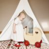 Moover Classic Pram in Natural with little girl and tent